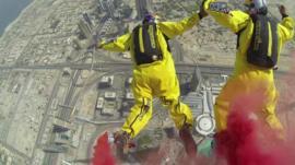 View as sky divers jump from Burj Khalifa