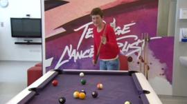 Nicolle playing snooker