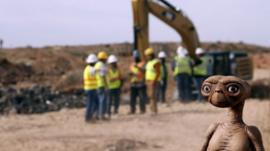 An E.T. doll is seen while construction workers prepare to dig into a landfill in Alamogordo, N.M., Saturday, April 26, 2014