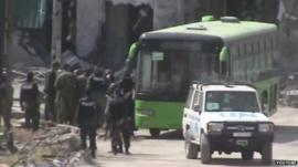 Police and passengers next to bus