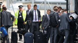 England football team at Luton Airport with suitcases