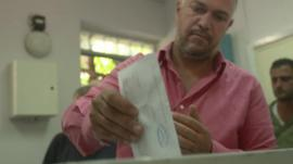 A man votes in Syria's presidential elections