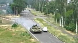 Amateur footage of a tank on a road