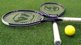 Tennis racquets and a tennis ball