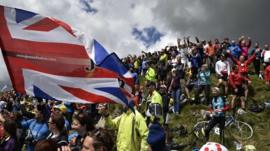 Supporters are pictured along the road during the 190.5 km first stage of the 101st edition of the Tour de France cycling race on July 5, 2014