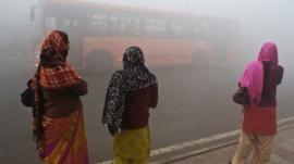 Indian women waiting for bus