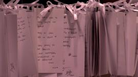Notes at a makeshift memorial for MH17 victims in a Malaysian shopping mall