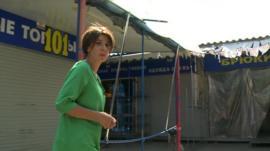 BBC correspondent Natalia Antelava surrounded by empty shops in Donetsk