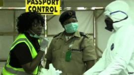 Screening staff at Nigeria's Murtala Muhammed International Airport in Lagos