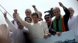 Imran Khan gestures as he heads a protest march from Lahore to Islamabad against the government, in Lahore on August 14, 2014