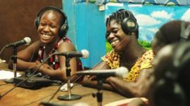 Radio presenting team in studio