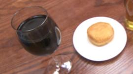Glass of wine and a doughnut