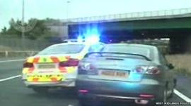 A police car blocks in a car containing two drug dealers following a high-speed car chase