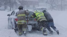 Men pushing a car in New York state