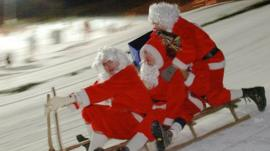 Santas on sleigh