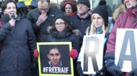 Ensaf Haidar holding a picture saying #freeraif