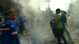 Petrobras workers burn their uniforms