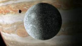 Ganymede foreground, Jupiter in background