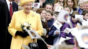 The Queen smiles at some of the many school children that came out to meet her at Duthie Park, Scotland, Tuesday May 28, 2002.