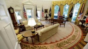 Pictured after refurbishment, the Oval Office has new, white, wallpaper.
