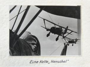 Photo taken from a Henschel aircraft towards the back of the plane shows two others following in a straight line in tight formation