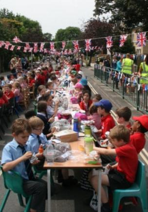 The Queen's C of E School and Kew College, London, held a street party to celebrate. Credit: The Queen's C of E School and Kew College