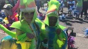 These girls dressed up as dinosaurs as part of their Carnival parade.