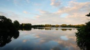 The sun prepares to set over Cosmeston Lakes in the Vale of Glamorgan, taken by Duncan McKellar
