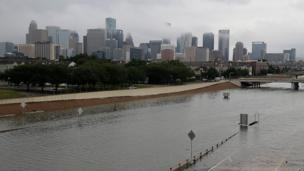 The US city of Houston in Texas has been battered by the biggest storm in its history, which has turned roads into rivers.