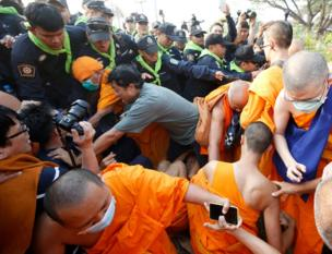 Thai Buddhist monks of Dhammakaya Temple and their supporters scuffle with police officers outside the temple in Pathum Thani province, on the outskirts of Bangkok, Thailand, 20 February 2017.