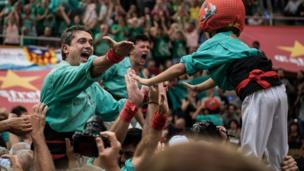 """Members of the colla """"Castellers de Vilafranca"""" celebrate after building a human tower during the 26th Tarragona Competition on October 2, 2016 in Tarragona, Spain."""