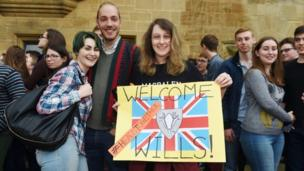 Biology student Katie Shepherd, 20, holds a banner which the Duke of Cambridge looked at when he arrived to tour Magdalen College