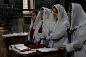 Syriac Christian girls, who are members of the choir, attend a mass on Christmas at the Virgin Mary Syriac Orthodox Church in Diyarbakir, Turkey, December 25, 2017