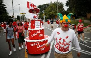 "People participate in the East York Toronto Canada Day parade, as the country marks its 150th anniversary with ""Canada 150"" celebrations, in Toronto, Ontario, Canada"