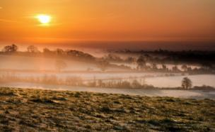 Fields are covered with layers of mist