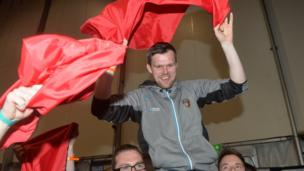 People Before Profit's Gerry Carroll celebrates topping the poll in West Belfast