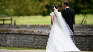 Pippa Middleton and her new husband James Matthews leave following their wedding ceremony.