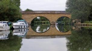 A reflection of Eynsham Toll Bridge photographed by Tony Simmons
