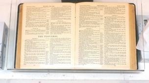 A Bible open to the book of Proverbs