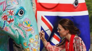 The Duchess of Cambridge decorates an elephant parade statue at the discovery park in Kaziranga
