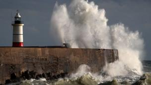 Massive waves crash against the harbour wall, as Storm Angus hits Newhaven in East Sussex over the weekend