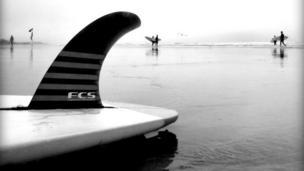 Surfer in Polzeath