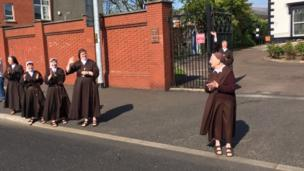 Martina Purdy and other nuns from the Sisters of Adoration cheer on competitors on the Falls Road, Belfast Coty Marathon, 1st May 2017