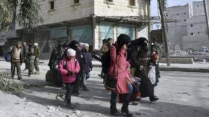 Residents flee east Aleppo as government forces push into rebel-held areas, 12 December 2016. Syria's military said Monday it has regained control of 98% of eastern Aleppo.