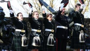 Cadets at Edinburgh Castle doff caps after firing salute