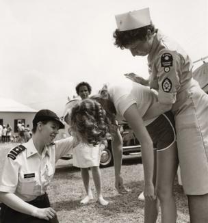 Volunteers demonstrate the Heimlich manoeuvre
