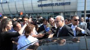 Egyptian Prime Minister Sherif Ismail talks to reporters at Cairo International Airport, Thursday, 19 May, 2016.