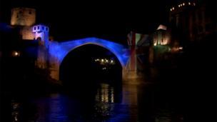 Old Bridge in Mostar illuminated in United Kingdom's flag colours.