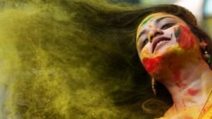 Woman with coloured powder in her hair