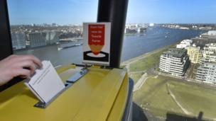 People casts their vote for the Dutch general election in a polling station on the twentieth floor of The A'dam Tower in Amsterdam, Netherlands, 15 March